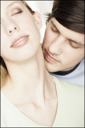 A man is kissing the neck of a woman whose head is tilted back and her eyes are closed. She is obviously enjoying this sensual moment. Magi Astrology can help you to identify a great lover.